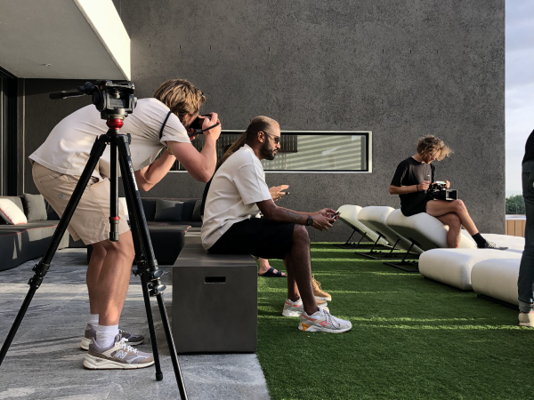 camera man taking photos of people being interviewed