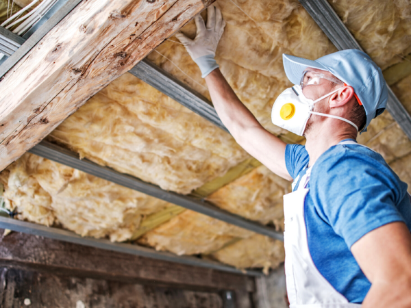 man installing roof insulation