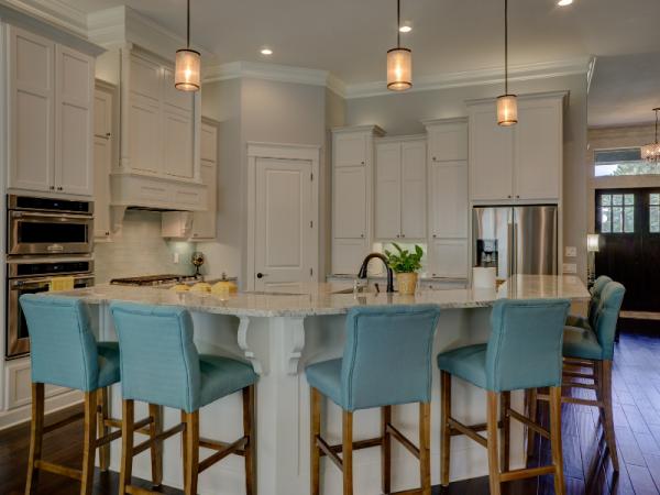 sleek pendant lights in cream kitchen