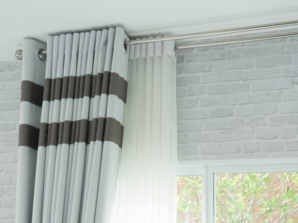 light grey curtains with dark grey thick stripes