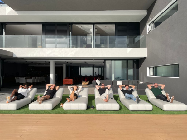 people lying on outdoor pillows